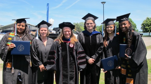 Faculty and graduates of UMass Boston's early education bachelor's degree program.  Anne Douglass is third from the right.