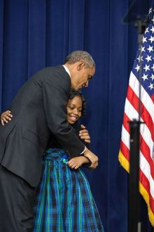 President Obama hugs Alajah, the third-grader who introduced him at the summit.  Photo: The White House.