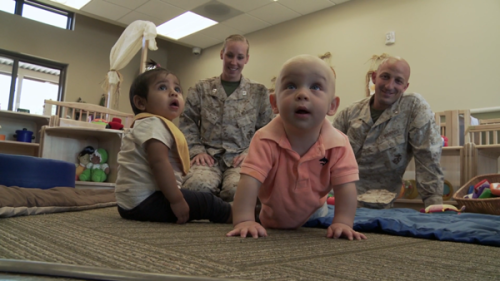 """The Barikbin family sends their toddler to a military child development center in the documentary series The Raising of America. Military child care is considered the highest quality in the nation, available to all military personnel and all of it affordable."" Source: http://www.raisingofamerica.org/press-kit#still-photos"